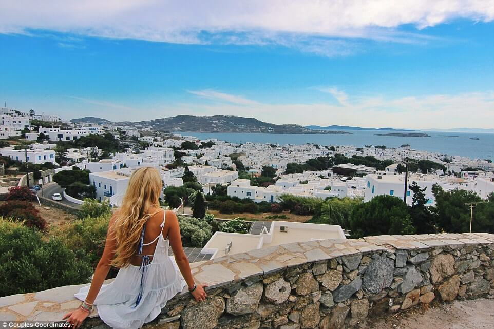 This guy photographs his model girlfriend as they travel for Hot vacation spots for couples