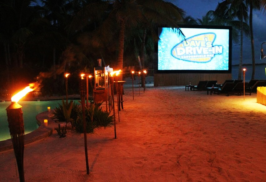 Most Expensive Private Island Rental | End your night with a movie at Dave's Drive-In!