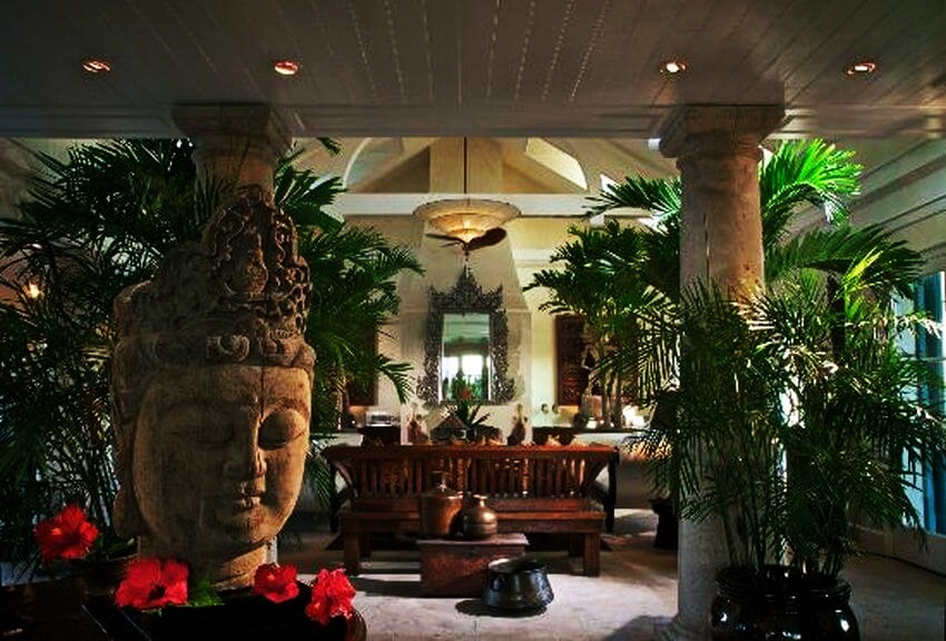 Most Expensive Private Island Rental | The living room decorated with artifacts looks great!