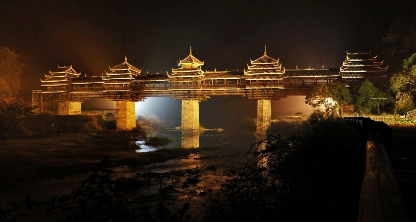 Top 5 Most Luxurious Bridges - EALUXE.COM | The Wind and Rain Bridge is a combination of bridge, corridor, veranda and Chinese pavilion which makes it so luxurious.