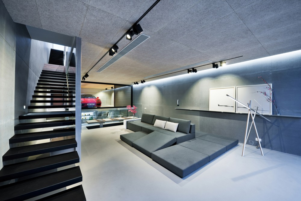 Incredible modern home features a ferrari in the living room