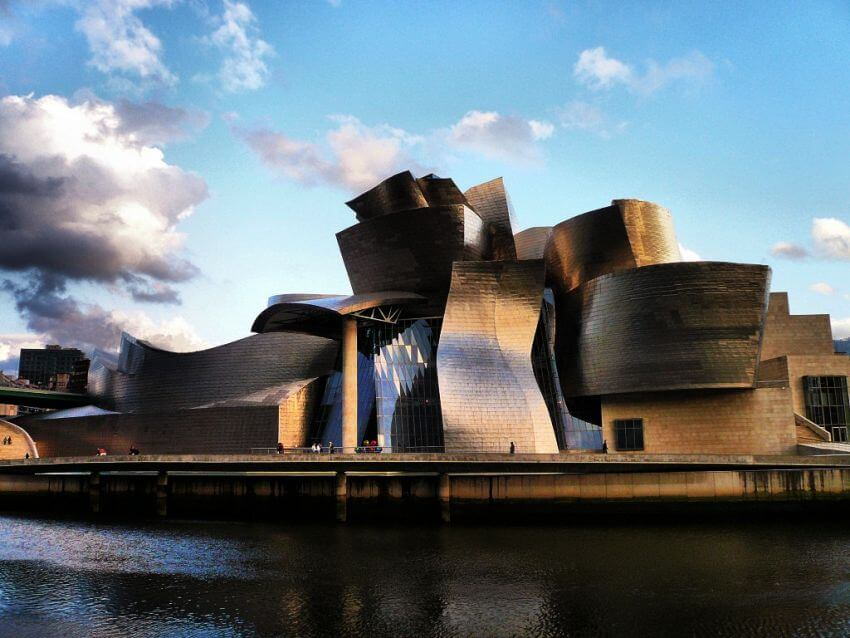 #9 The Guggenheim Museum, Abando, Bilbao, Spain | 10 Buildings You Need To See Before You Die [ Image Source: raredelights.com]