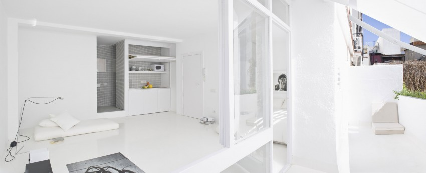 Studio Apartment Minimalist inside this minimalist all white seaside studio apartment