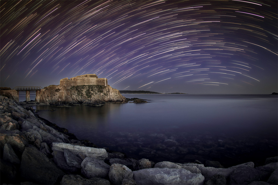 Star Trails Over Fort At La Tour Fondue, Southern France - Photo by Christoph Schaarschmidt
