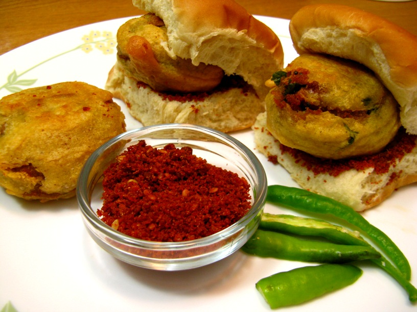 THESE ARE THE THREE MOST SIMPLE SANDWICHES THAT RICH PEOPLE DIE FOR | 2.Traditional Indian VADA PAV Sandwich next to spices.
