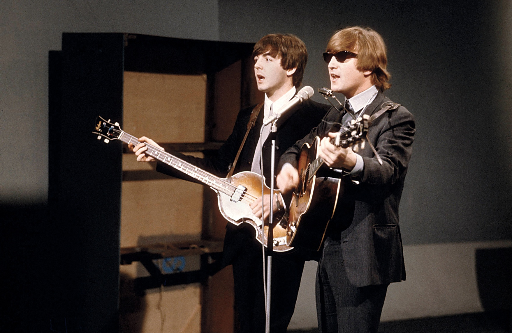 a comparison of the john lennon and paul mccartney from the music band the beatles