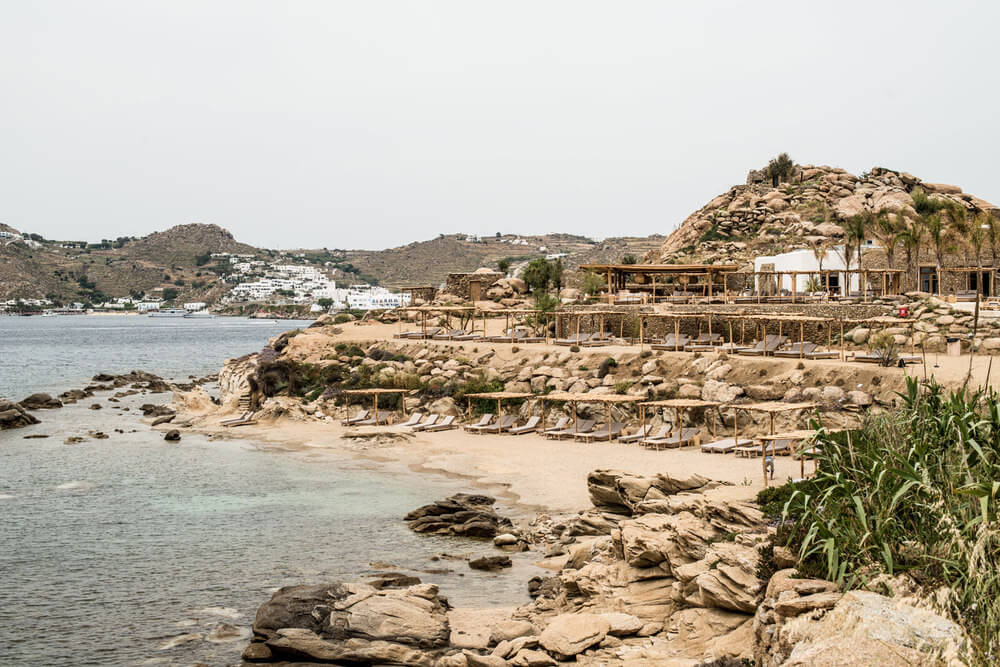 These 20 Photos of a Luxurious Mykonos Beach Club Will Make You Hate Your Home