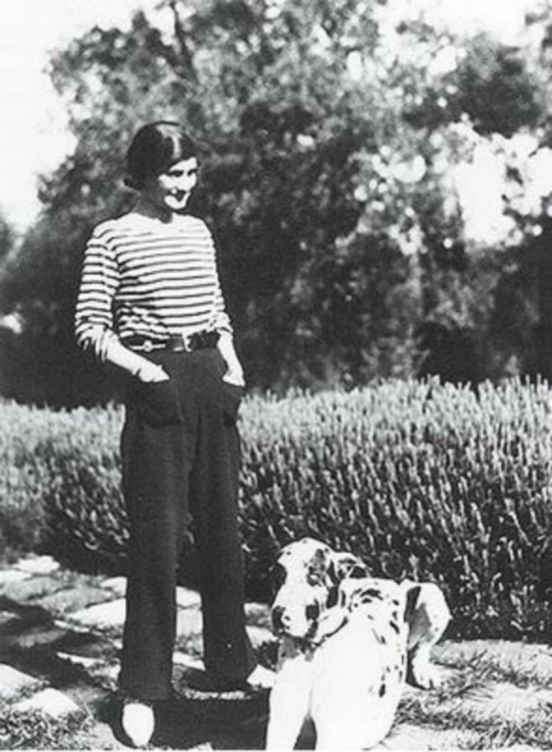 15 Things You Didn't Know About Coco Chanel | Coco Chanel with her dog, circa 1930