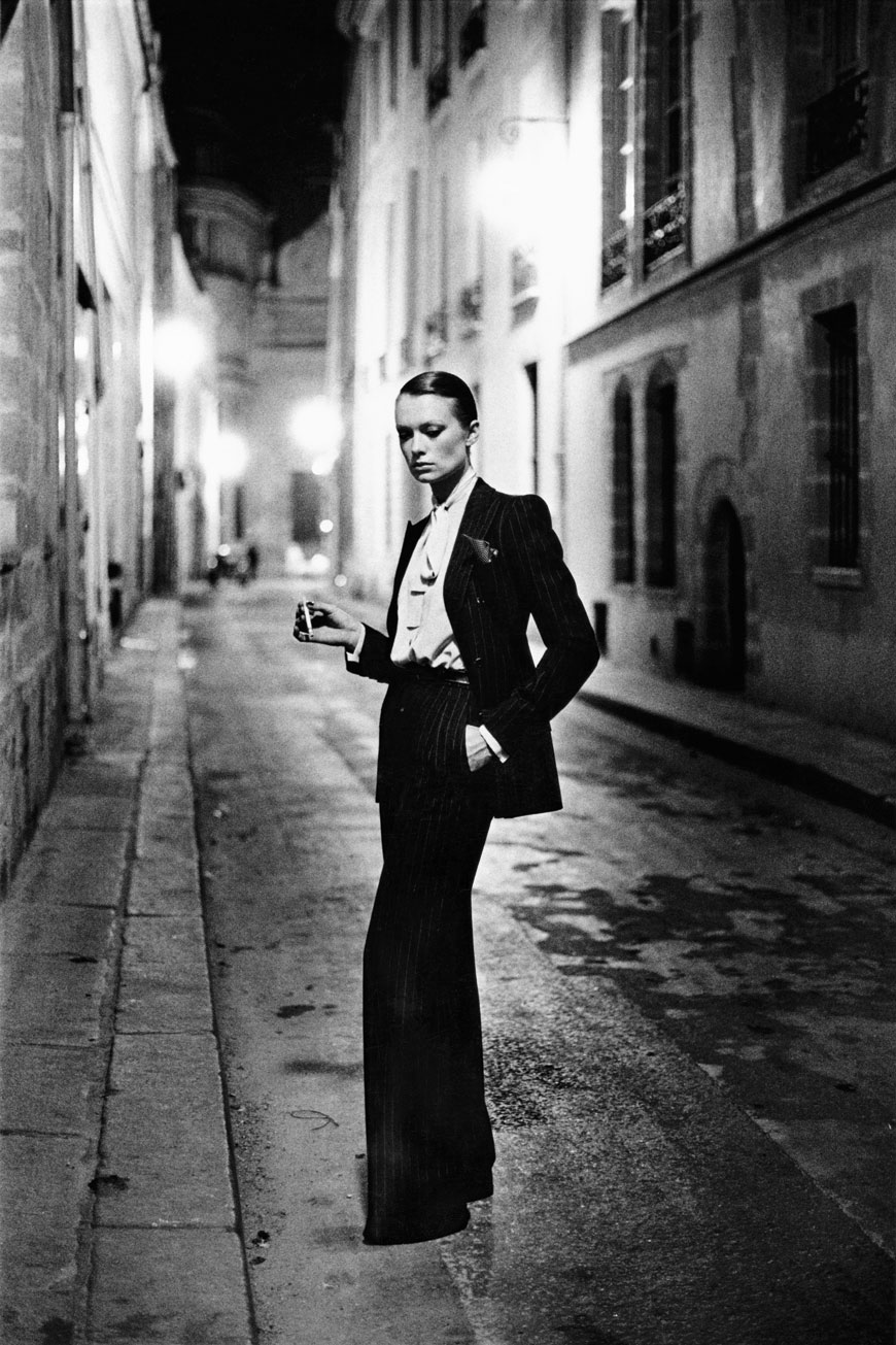 Top 10 Oldest Fashion Houses| YSL's Le Smoking, photographed by Helmut Newton in 1975. Image courtesy of The Grand Palais and Helmut Newton Estate