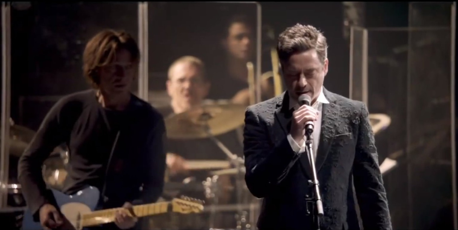 10 Things You Didn't Know About Robert Downey Jr.| Robert Downey Jr. singing at a party
