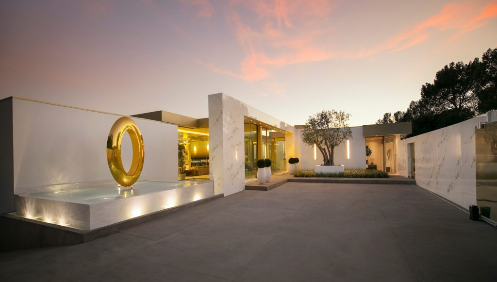 This $100M Beverly Hills Mansion Comes With Exotic Cars and a Champagne Vault