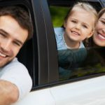 happy-family-posing-inside-their-car-dp